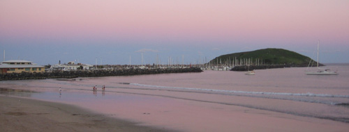 Jetty Beach, the marina and Muttonbird Island glowing just after sunset