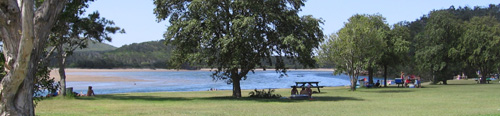The picturesque park by Red Rock River invites a rest, picnic and a swim