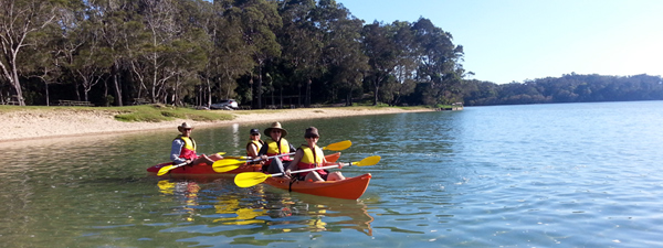 Kayaking with friends on beautiful Boambee Creek in Sawtell on the Coffs Coast